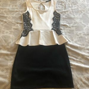 Dresses & Skirts - White and black peplum dress with lace detail